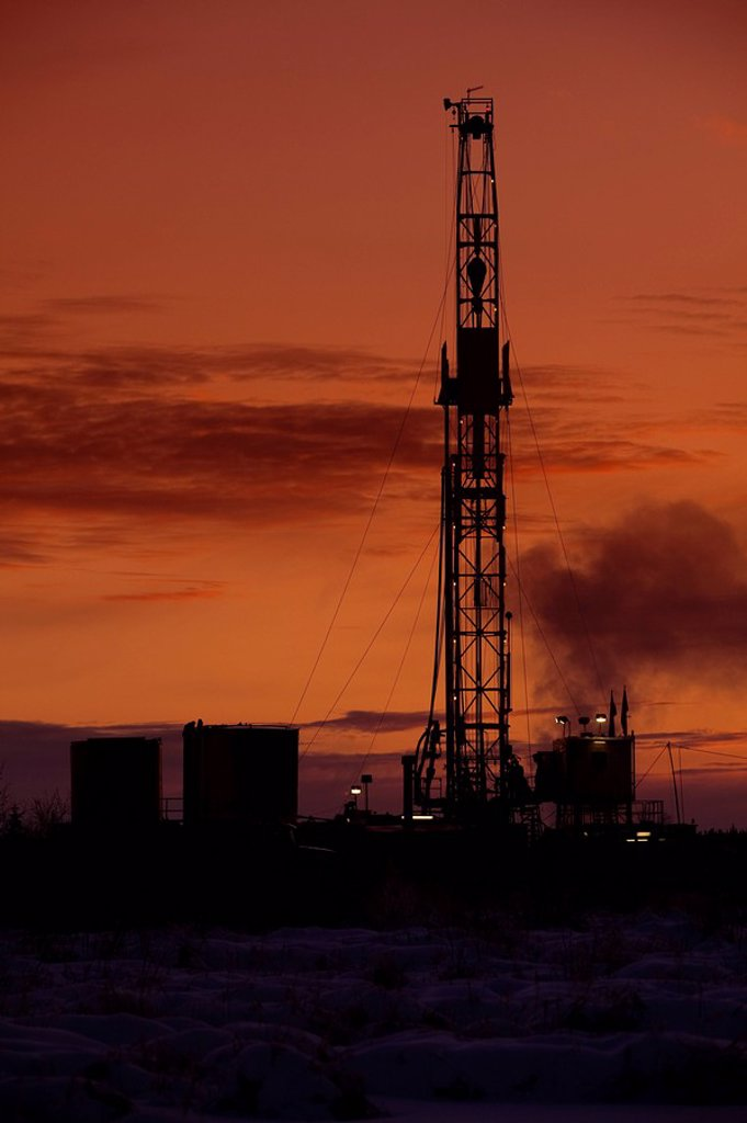 Oil drilling rig at dusk : Stock Photo