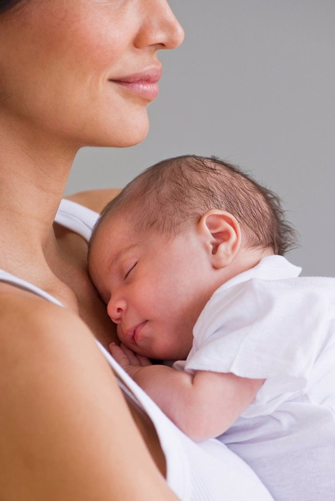 Mother holding sleeping baby : Stock Photo
