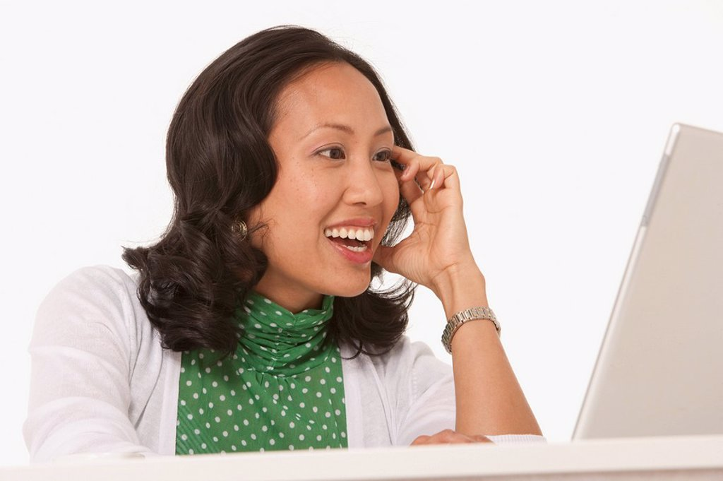 Happy woman looking at laptop : Stock Photo