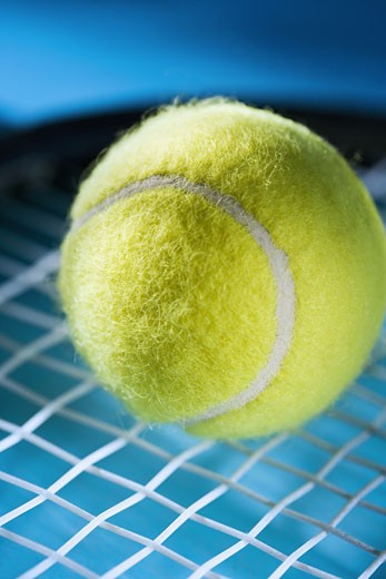 Closeup of tennis racquet and ball : Stock Photo