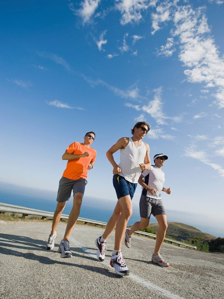 Runners on a road in Malibu : Stock Photo