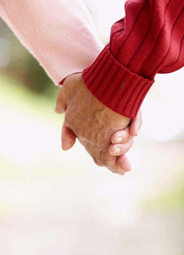 Two people holding hands : Stock Photo