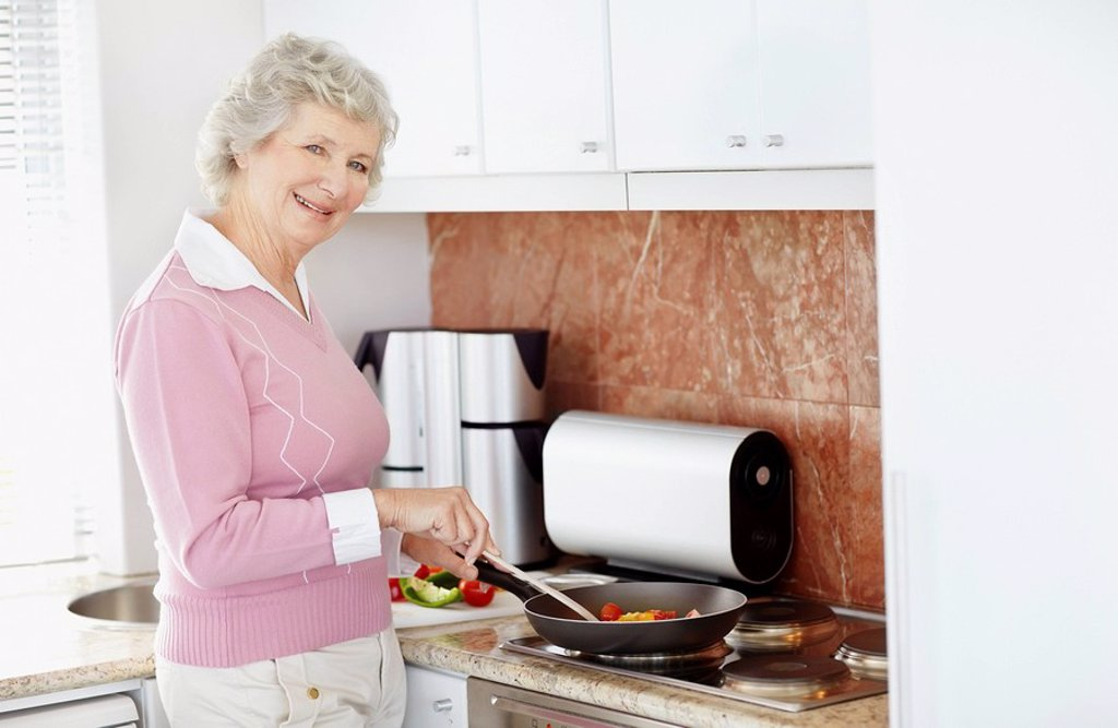 Senior woman cooking : Stock Photo