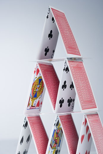 Stock Photo: 1795R-3156 Playing cards stacked into a pyramid