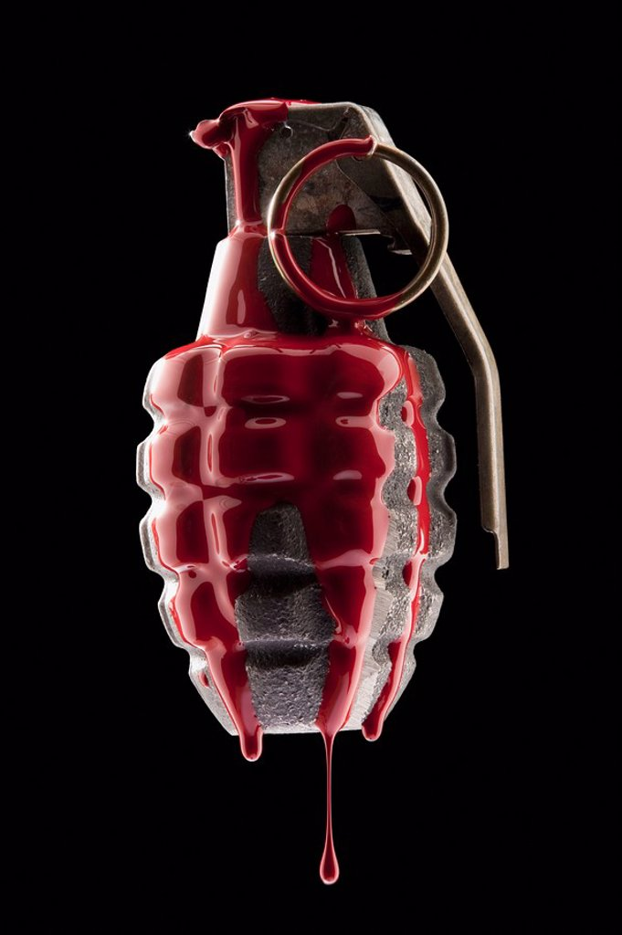 Red paint on grenade : Stock Photo