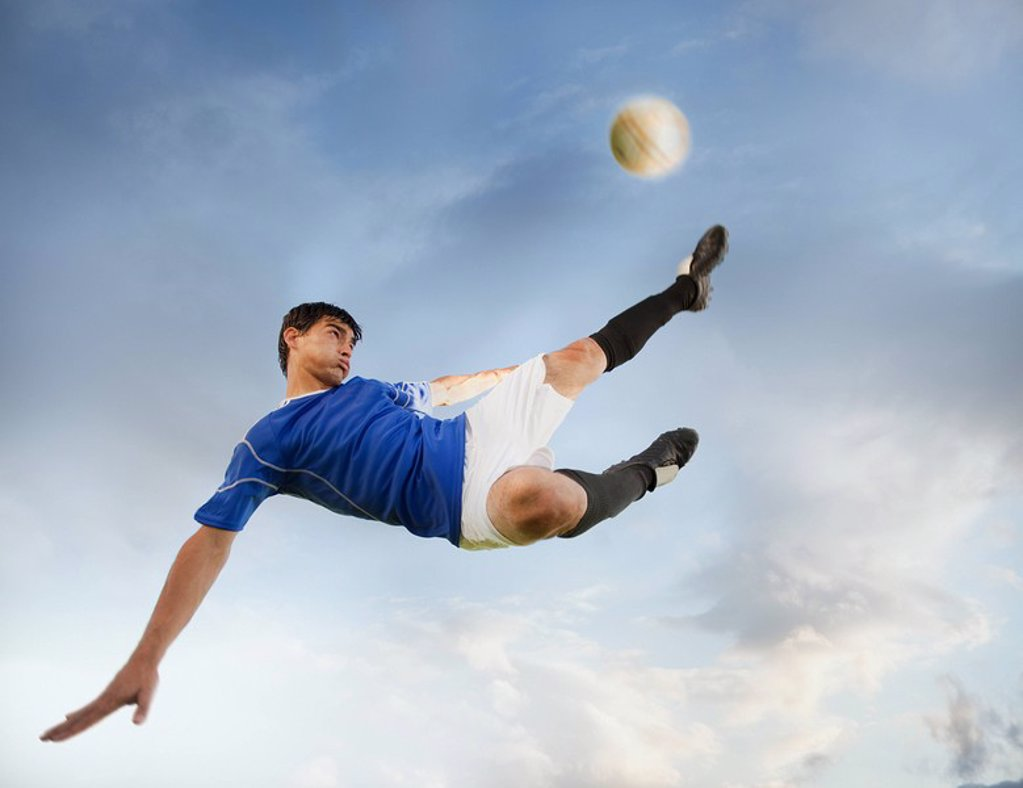 Soccer player kicking ball : Stock Photo