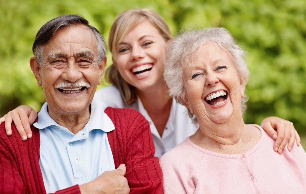 Three people laughing : Stock Photo