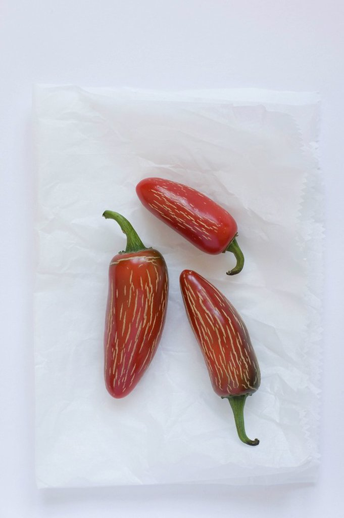 Three spicy fresno peppers : Stock Photo