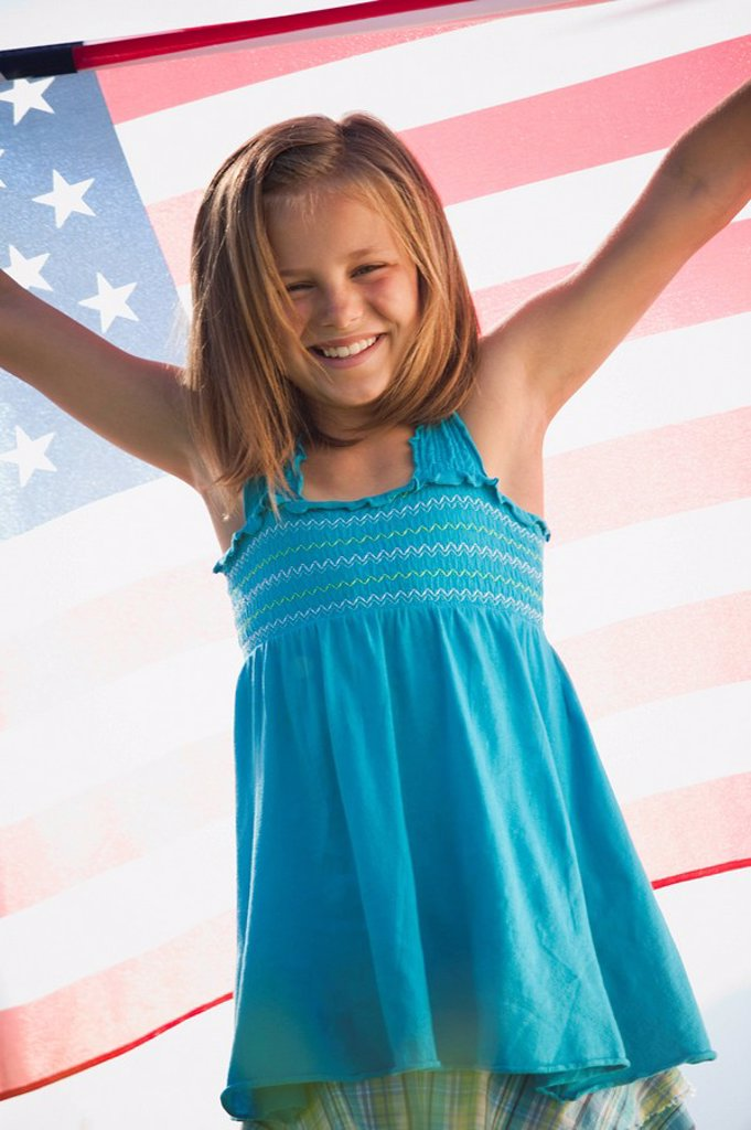 Stock Photo: 1795R-32330 Young girl holding American flag