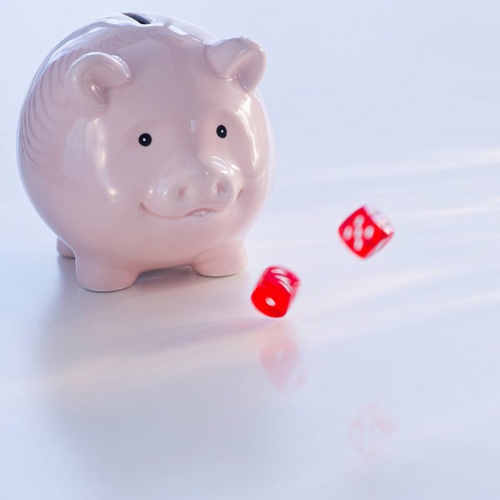 Piggy bank and dice : Stock Photo