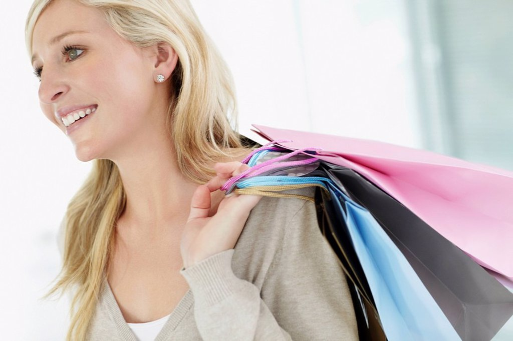 Attractive woman holding shopping bags : Stock Photo
