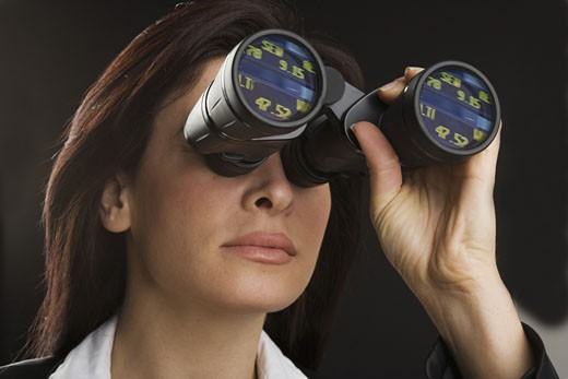 Stock Photo: 1795R-3321 Woman looking through binoculars