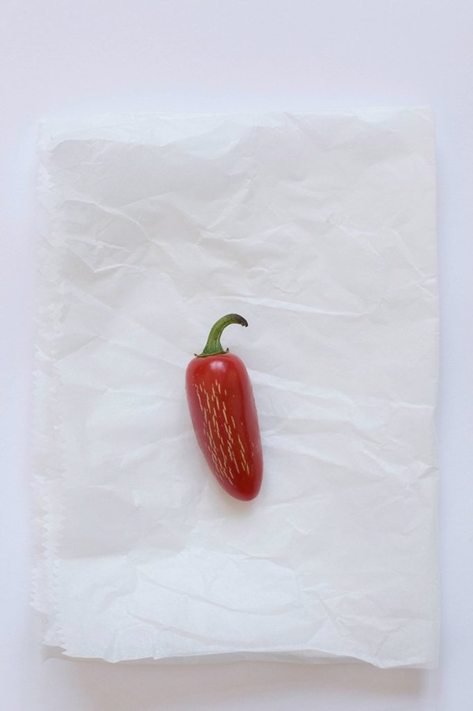 Stock Photo: 1795R-33514 Fresno pepper on parchment paper