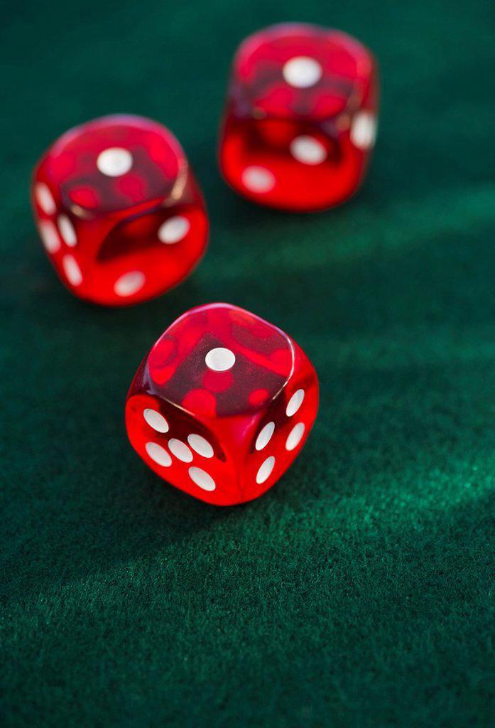 Stock Photo: 1795R-33660 Red dice on green felt