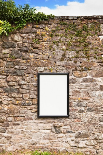 Blank sign on stone wall : Stock Photo