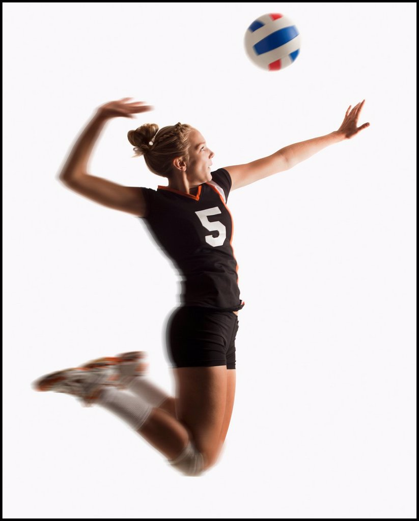 Stock Photo: 1795R-34948 Young girl 16_17 playing volleyball