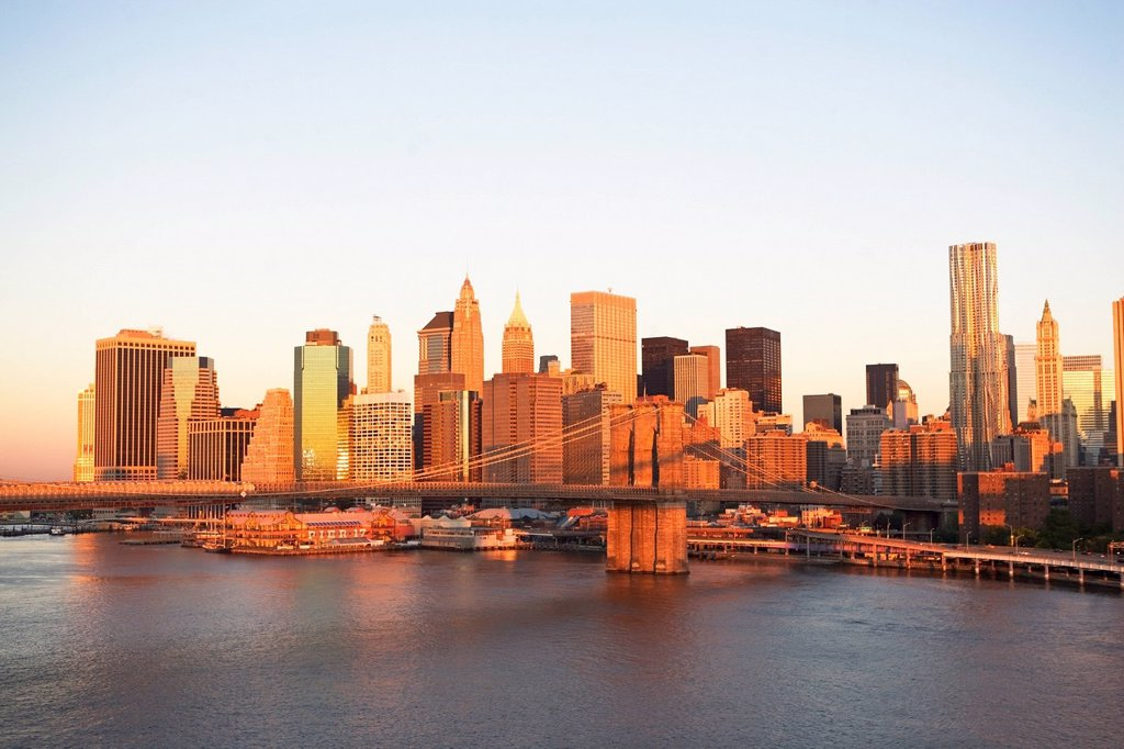 USA, New York State, New York City, Brooklyn Bridge and Manhattan skyline at sunset : Stock Photo