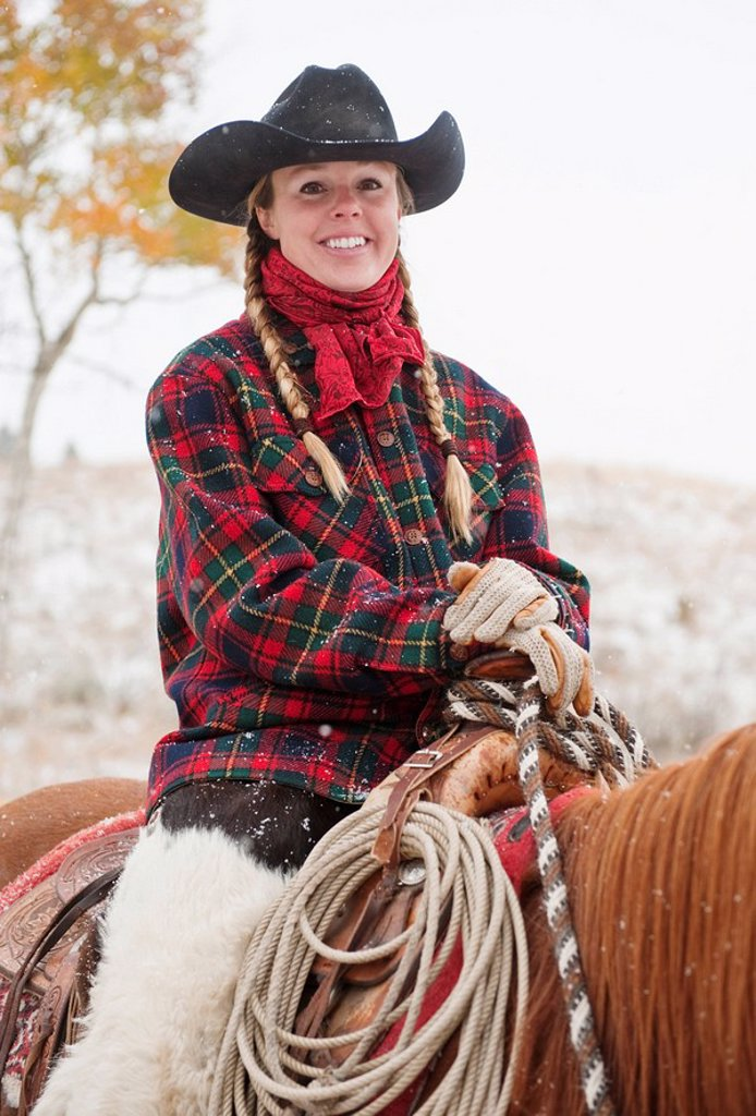 Cowgirl on horse : Stock Photo