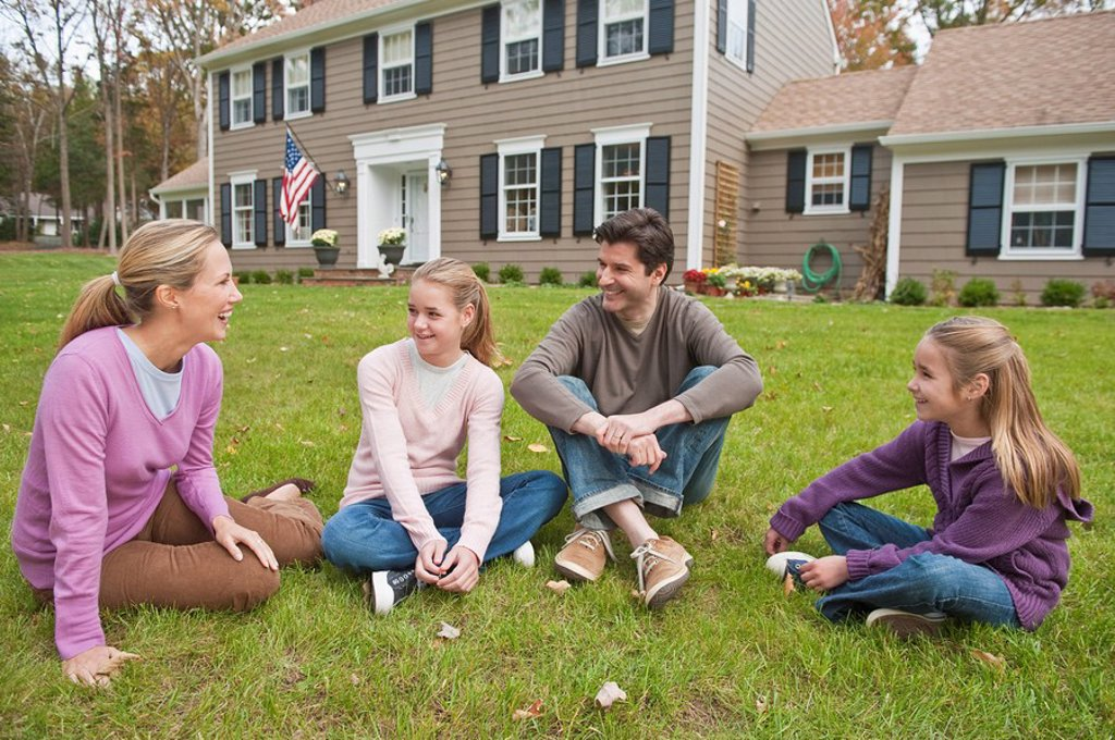 Family in front of house : Stock Photo