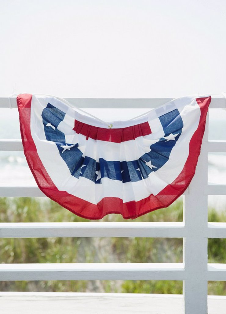 American flag decoration on fence : Stock Photo
