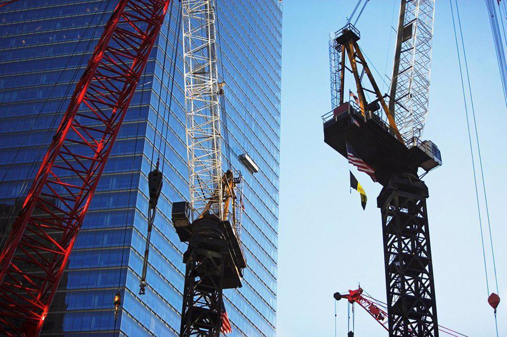 Cranes beside skyscraper : Stock Photo