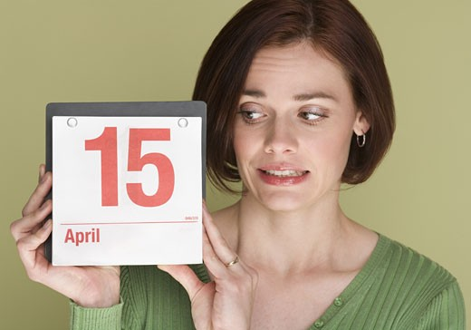 Woman worried about tax deadline : Stock Photo