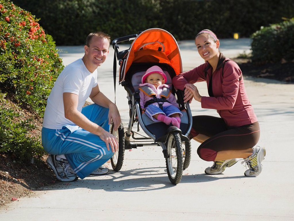 Parents and stroller : Stock Photo