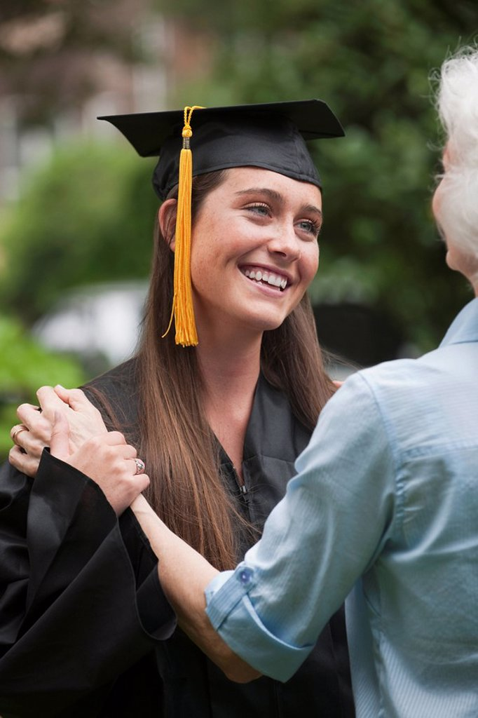 Graduate and elderly woman : Stock Photo