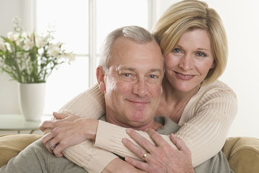 Stock Photo: 1795R-3784 Portrait of couple relaxing at home