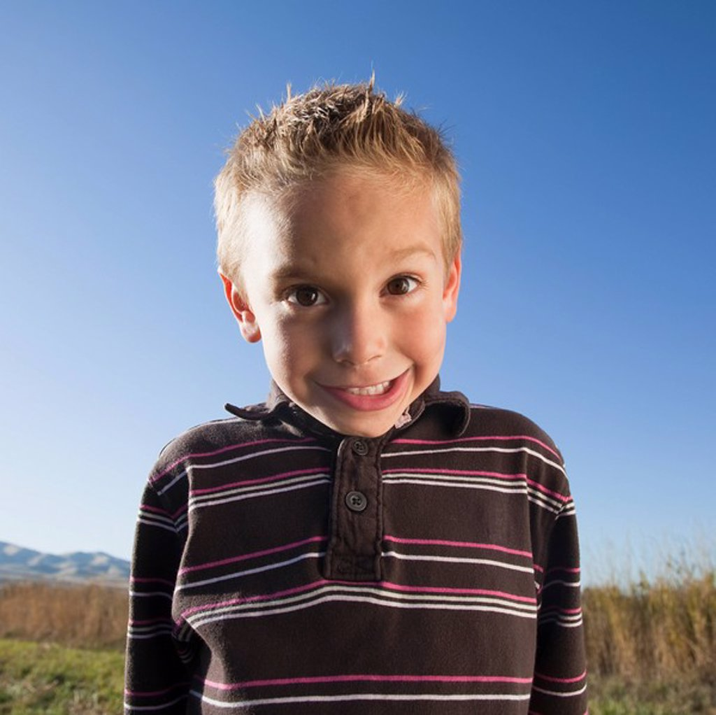 Stock Photo: 1795R-38182 Young boy with goofy expression