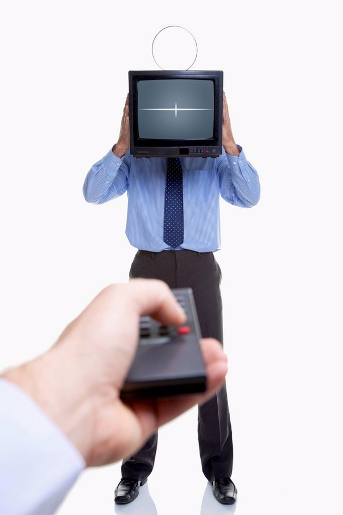 Stock Photo: 1795R-38204 Man holding television and remote