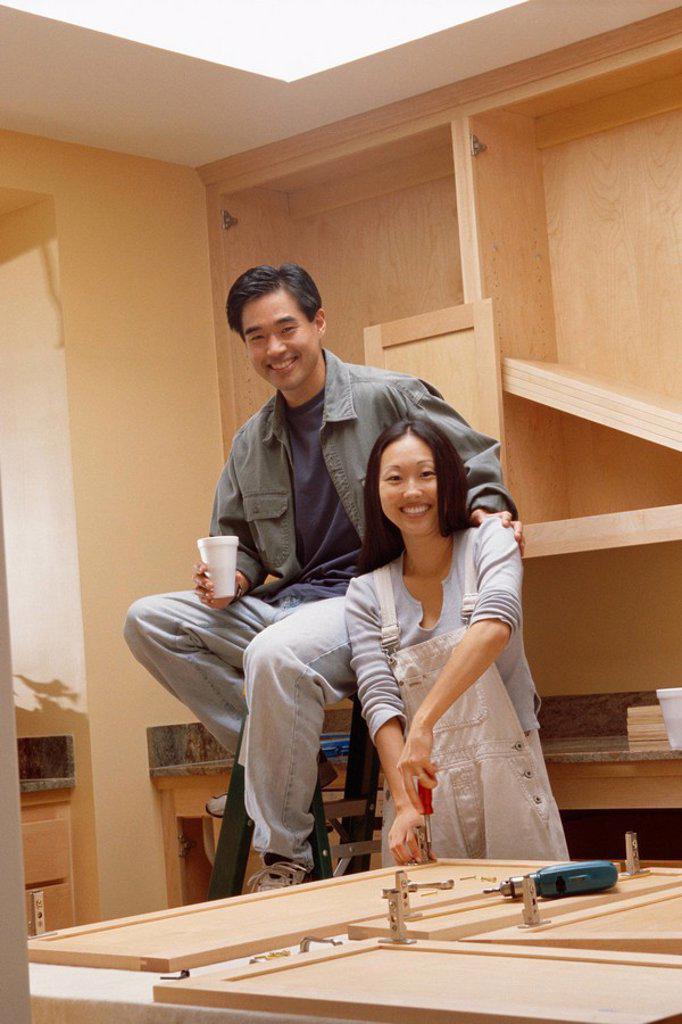 Couple remodeling kitchen : Stock Photo