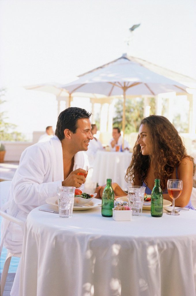 Couple in robes eating outside : Stock Photo