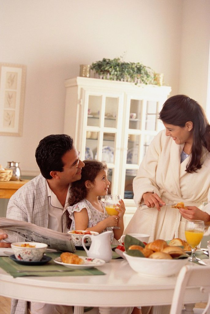 Family eating breakfast : Stock Photo