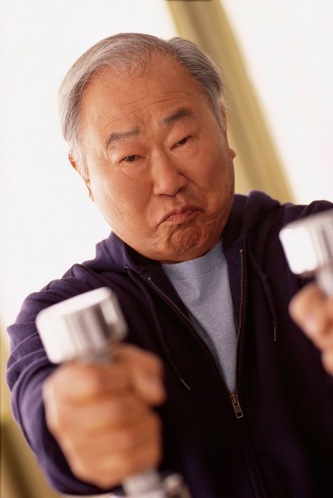 Man using dumbbells : Stock Photo