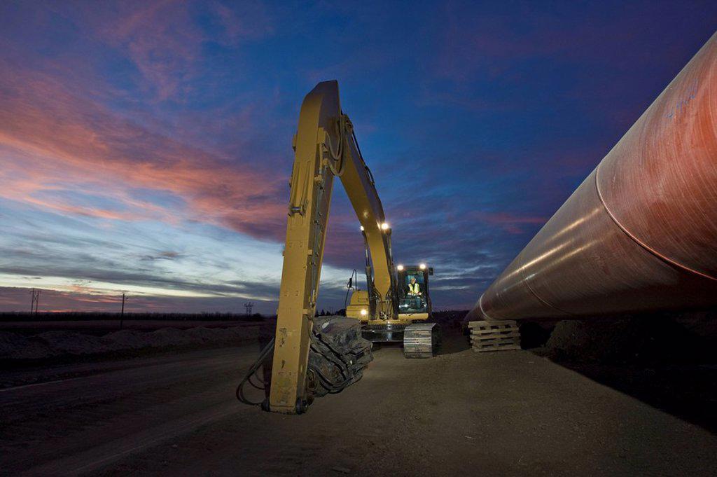 Heavy equipment beside pipeline : Stock Photo