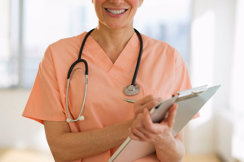 Stock Photo: 1795R-39131 USA, New Jersey, Jersey City, Female doctor writing medical report