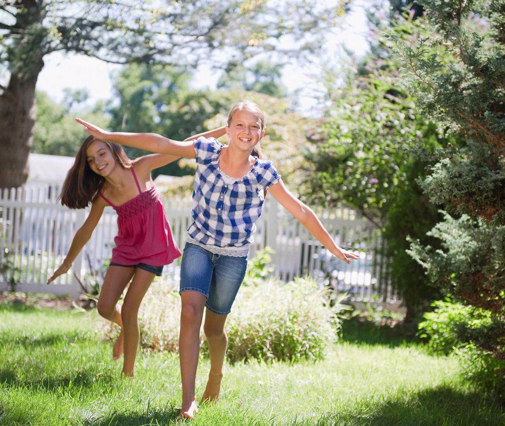 USA, New York, Two girls 10_11, 10_11 playing in backyard : Stock Photo