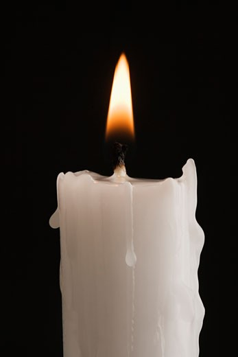 Stock Photo: 1795R-3973 Closeup of a burning candle