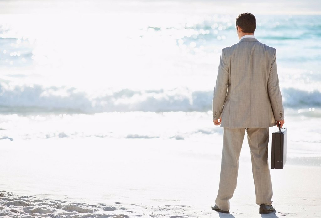 Stock Photo: 1795R-40140 South Africa, Businessman standing, rear view
