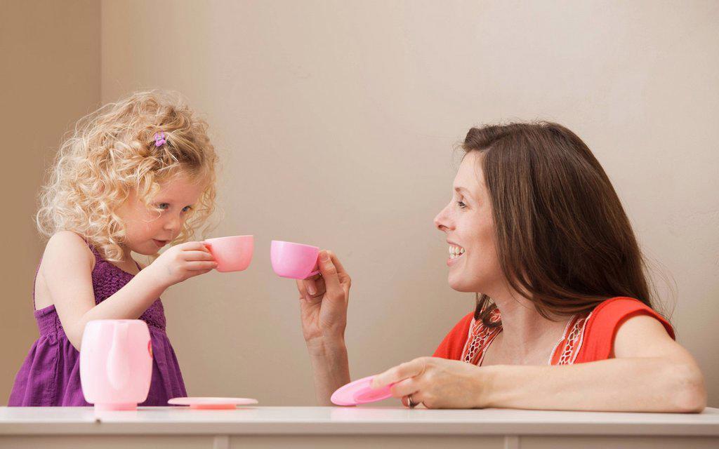 Stock Photo: 1795R-40355 USA, Utah, Lehi, mother and daughter 2_30 having tea