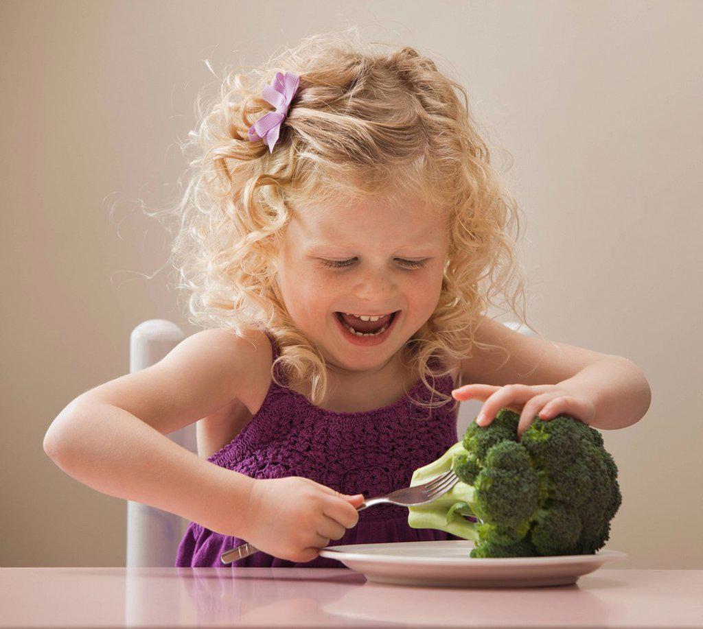 USA, Utah, Lehi, girl 2_3 eating broccoli : Stock Photo