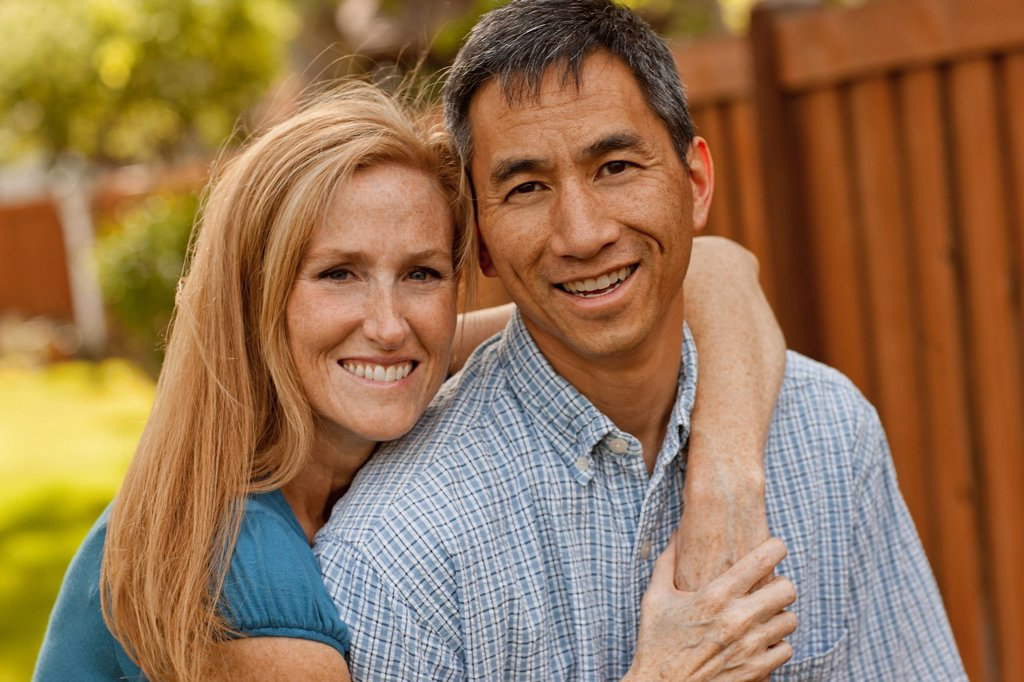 USA, Utah, Provo, Portrait of smiling mature couple in garden : Stock Photo