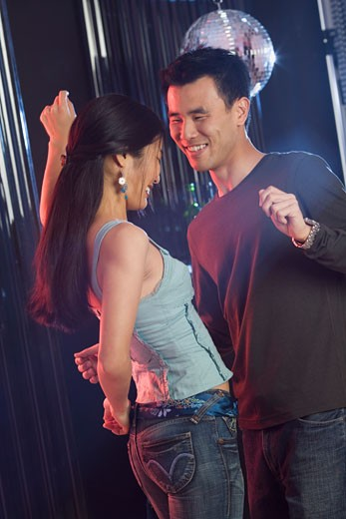 Stock Photo: 1795R-4109 Couple dancing in a nightclub