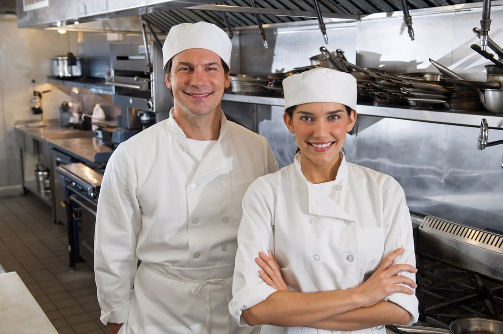 Stock Photo: 1795R-41407 Chef and cook in commercial kitchen