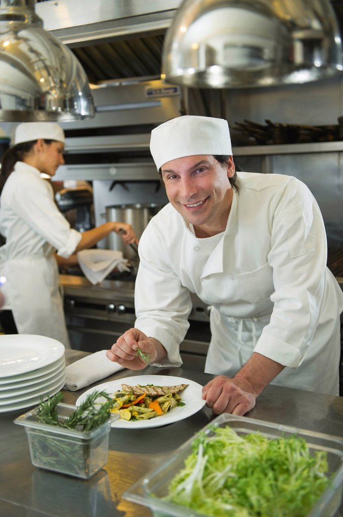 Stock Photo: 1795R-41423 Chef and cook preparing food in commercial kitchen