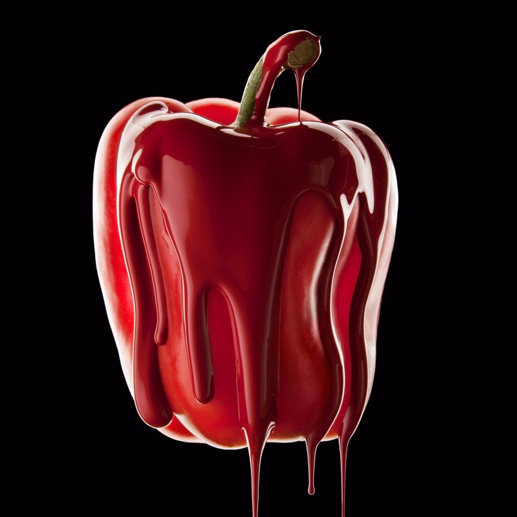 Stock Photo: 1795R-42305 Studio shot of red bell pepper covered with red paint