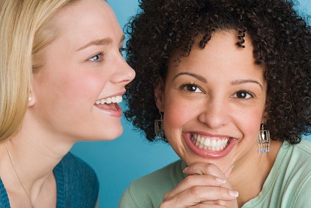 Closeup of two smiling women : Stock Photo