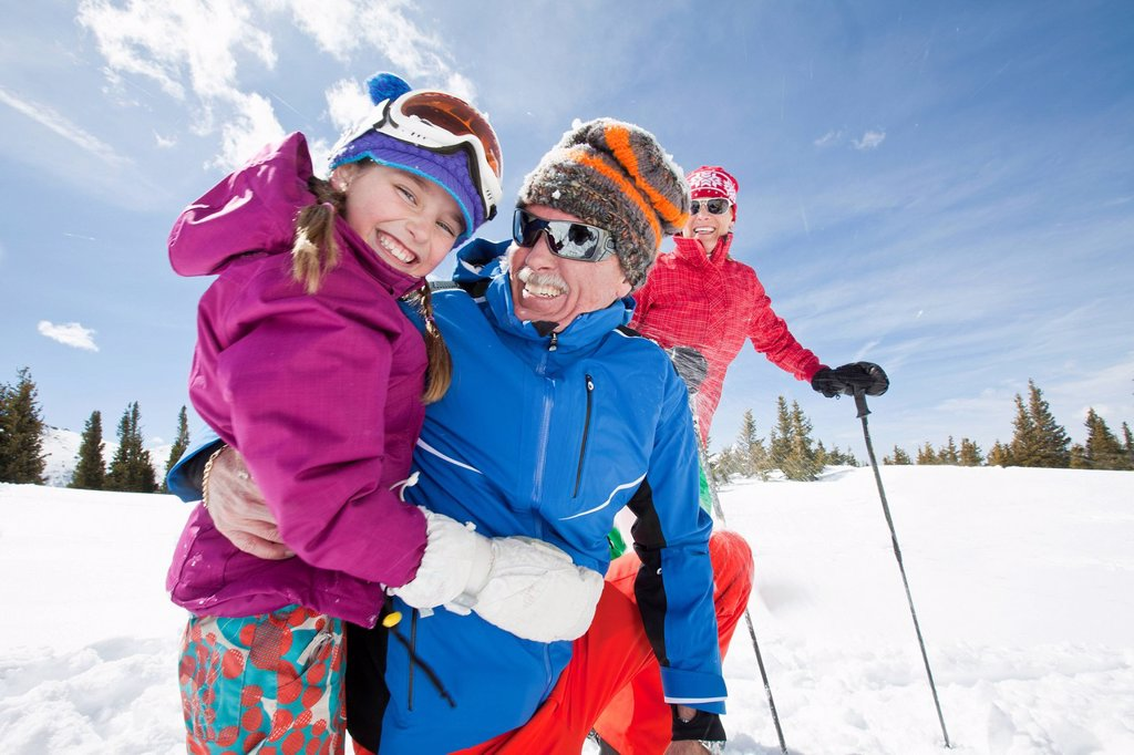USA, Colorado, Telluride, Grandparents with girl 10_11 posing during ski holiday : Stock Photo