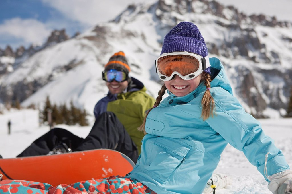 USA, Colorado, Telluride, Father and daughter 10_11 posing with snowboards in winter scenery : Stock Photo